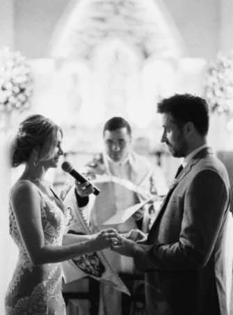 bride and groom reciting religious wedding vows