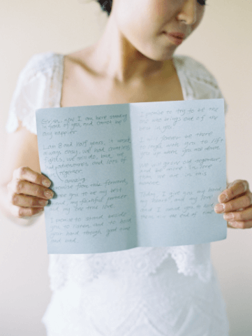 bride with handwritten wedding vows