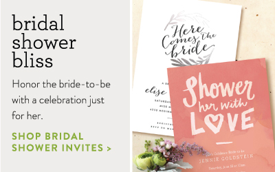 two bridal shower invitations. one is red, the other is white with foil-pressed leaves