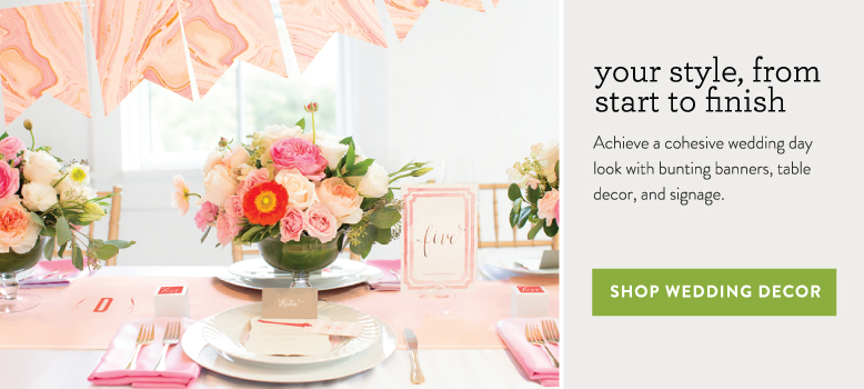 pink wedding table decor on display with matching table number and bunting banner