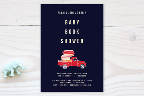 books stacked in back of truck baby shower invitation