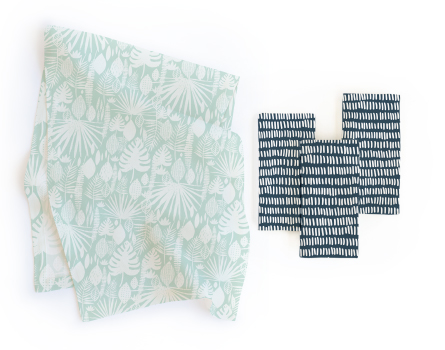 """Tropical Leaves"" runner paired with ""Division"" napkins."