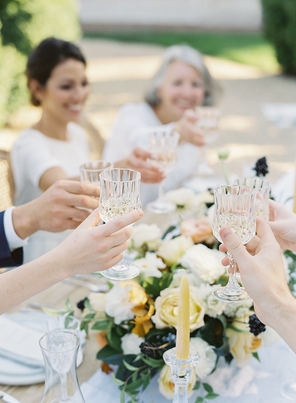 glasses toasting at wedding