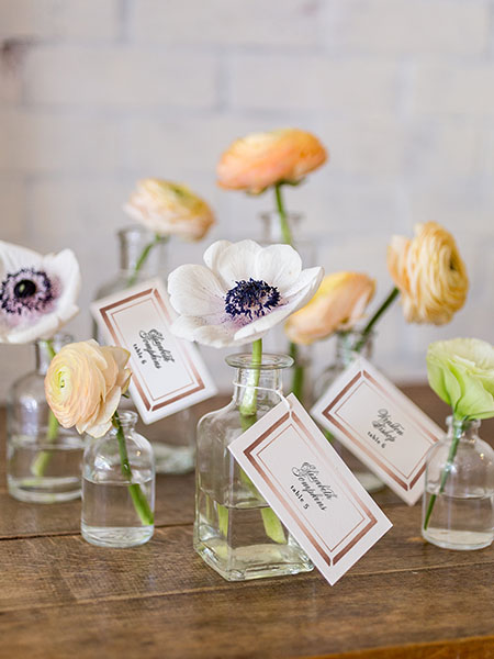 escort cards with flowers in vases