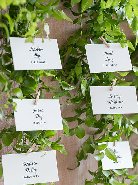 escort cards with vines of greenery