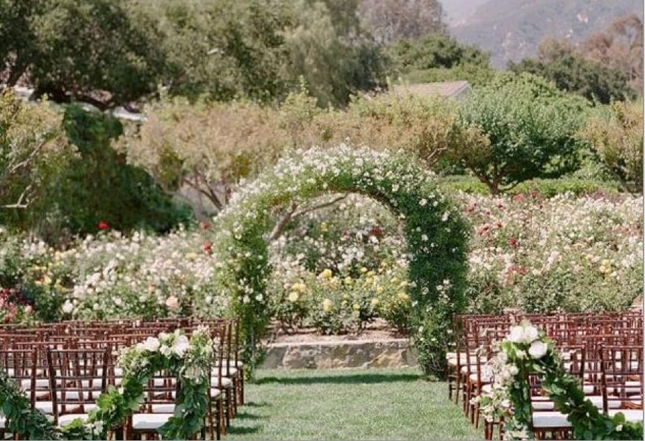 wedding ceremony set up with botanical arch