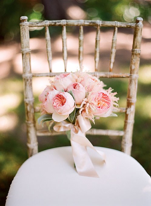 bouquet of garden roses on a chair