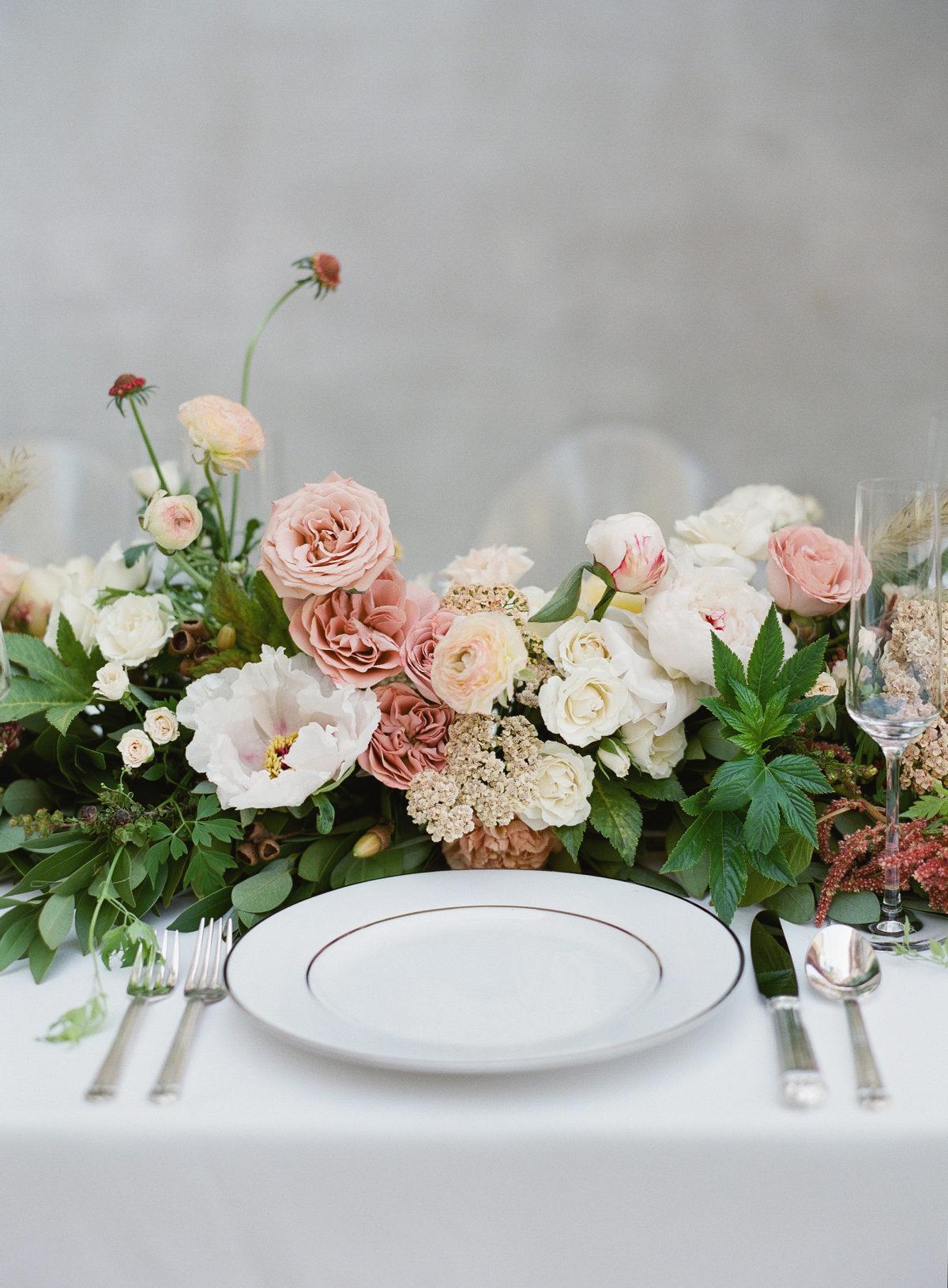 Flowers at wedding dinner table