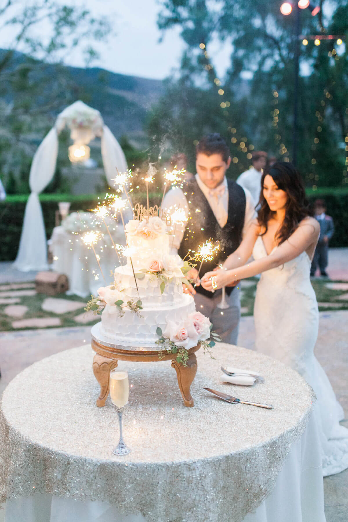 Brides and groom cutting cake