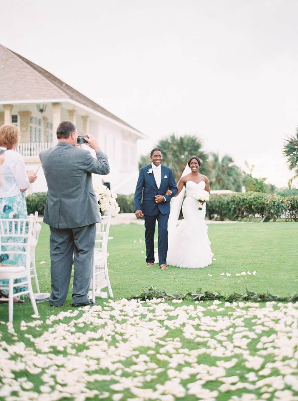 Couple taking wedding photos
