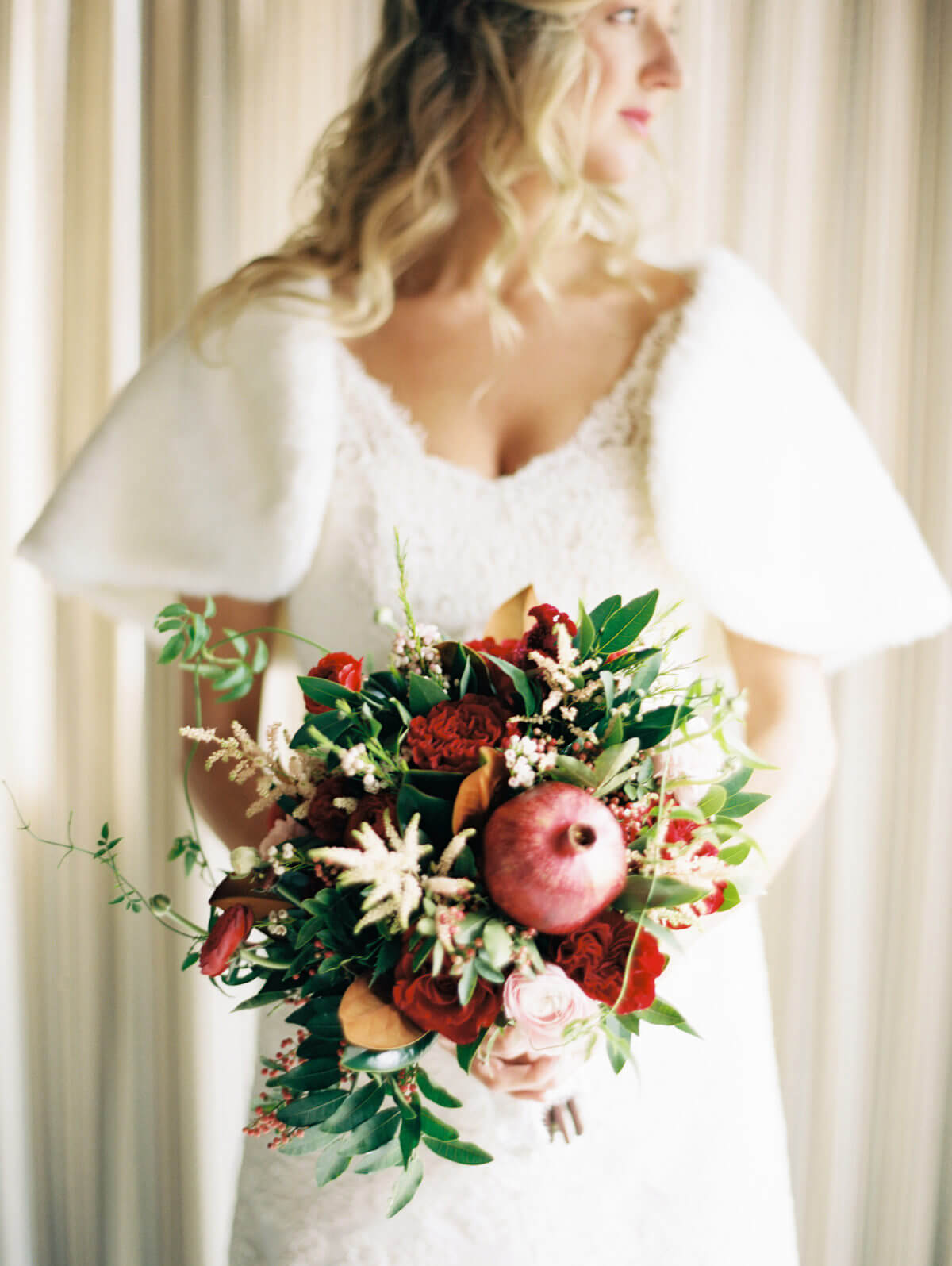Bride holding winter flowers