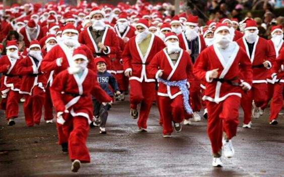 people dressed up as santas for holiday fun run