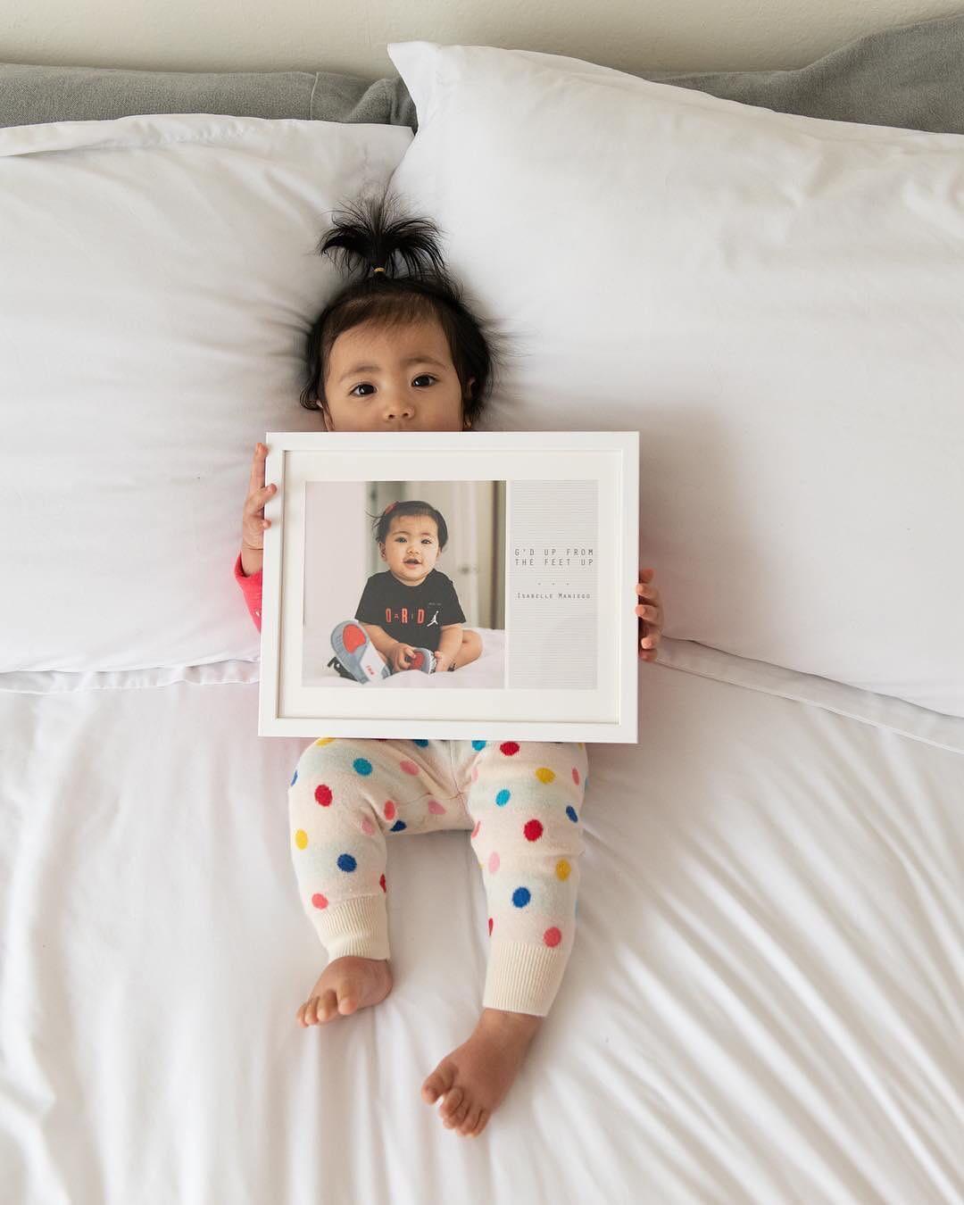 Baby holding photo art print