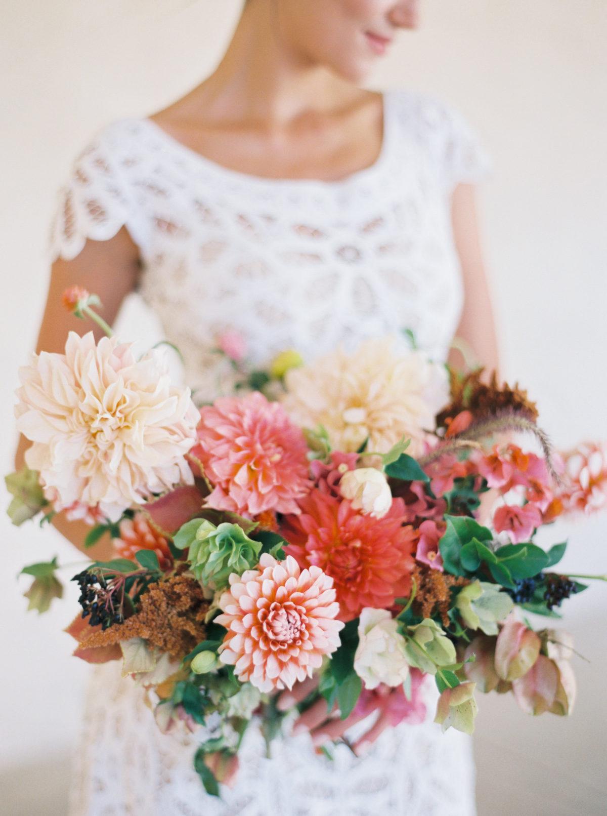 bride holding bouquet of dahlias
