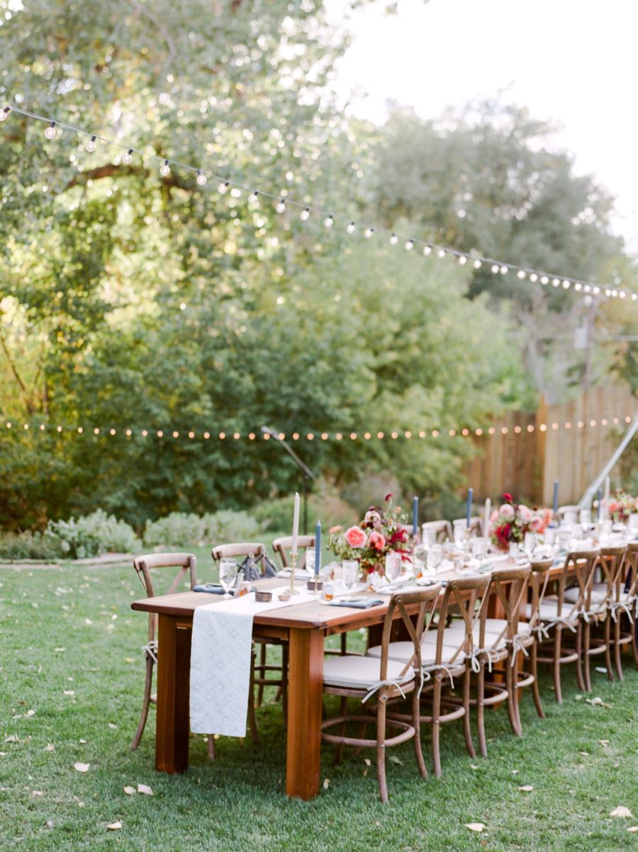 wedding dinner table set up in backyard