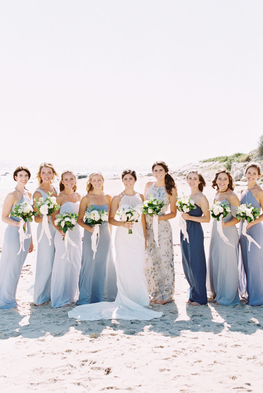 Bride and bridesmaid on beach
