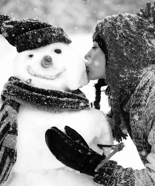 person kissing snowman