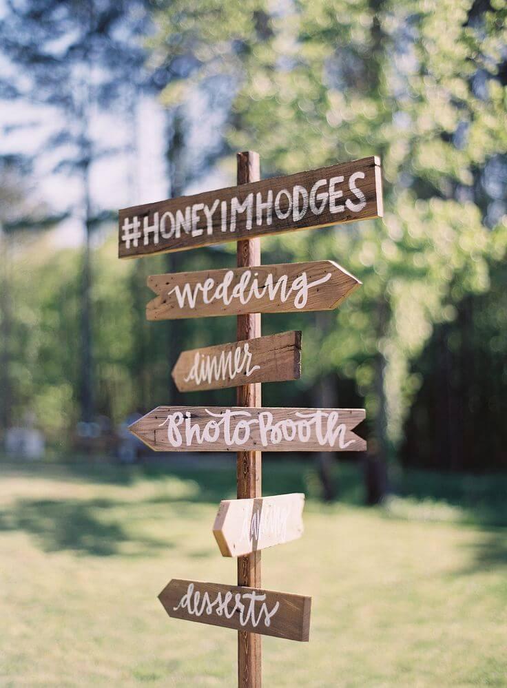 Wedding directional sign with wedding hashtag