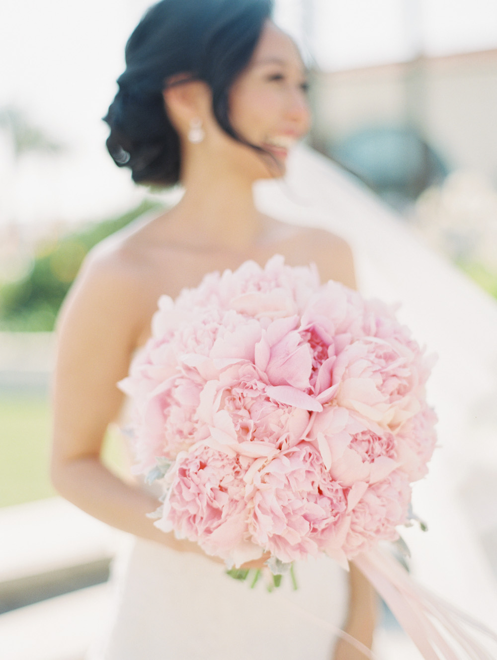 bride holding peonies flower bouquet