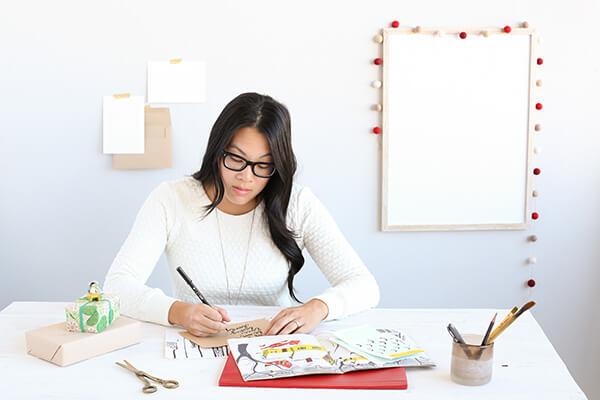 Woman making holiday card