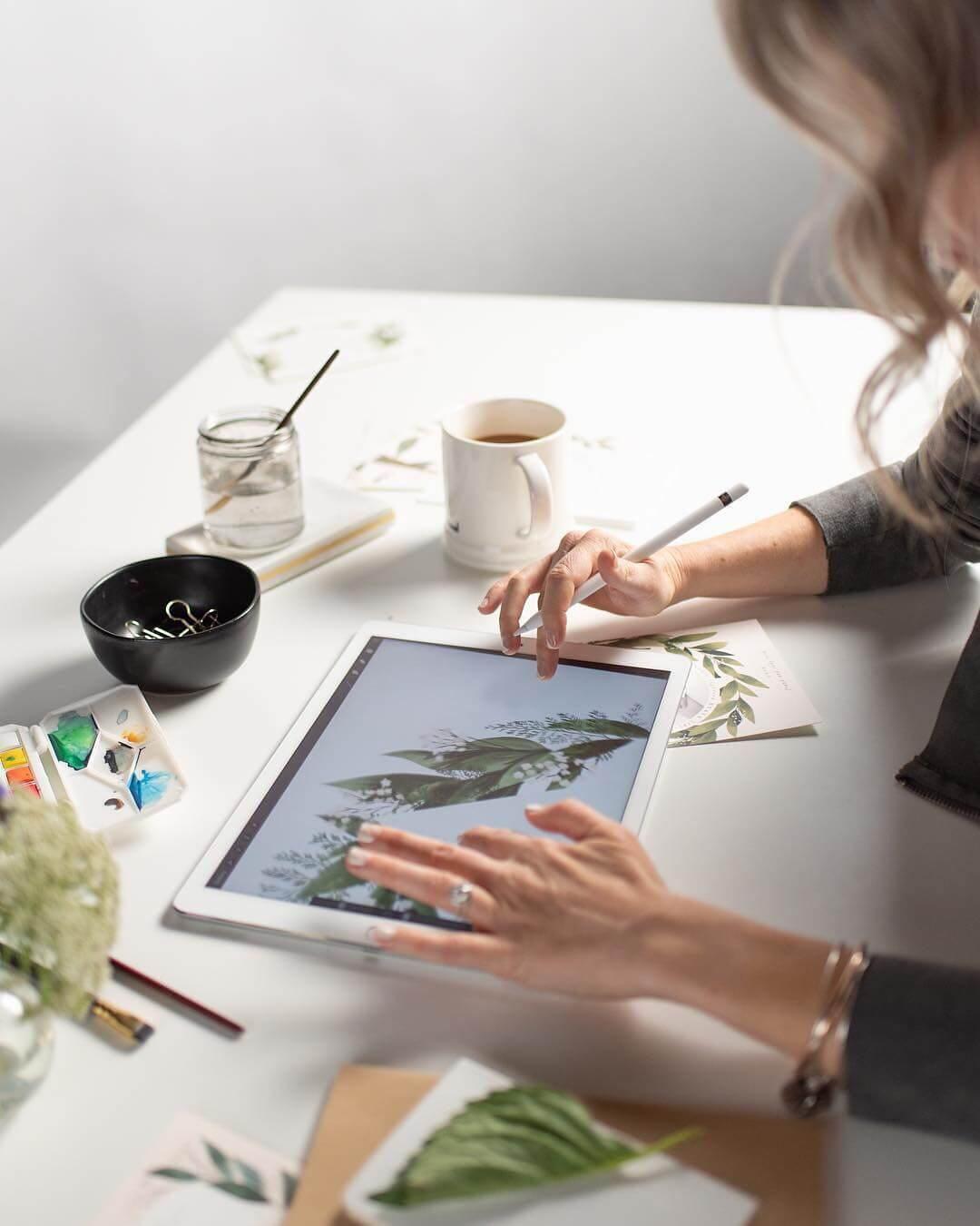 Woman customizing design on screen