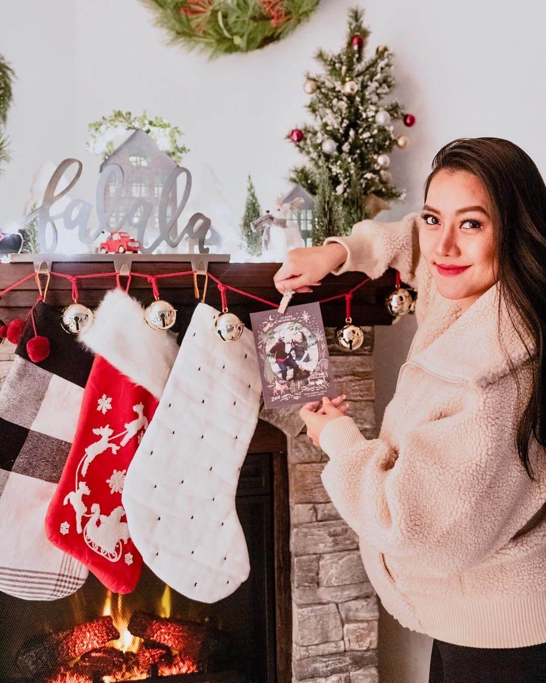 Woman hanging stockings
