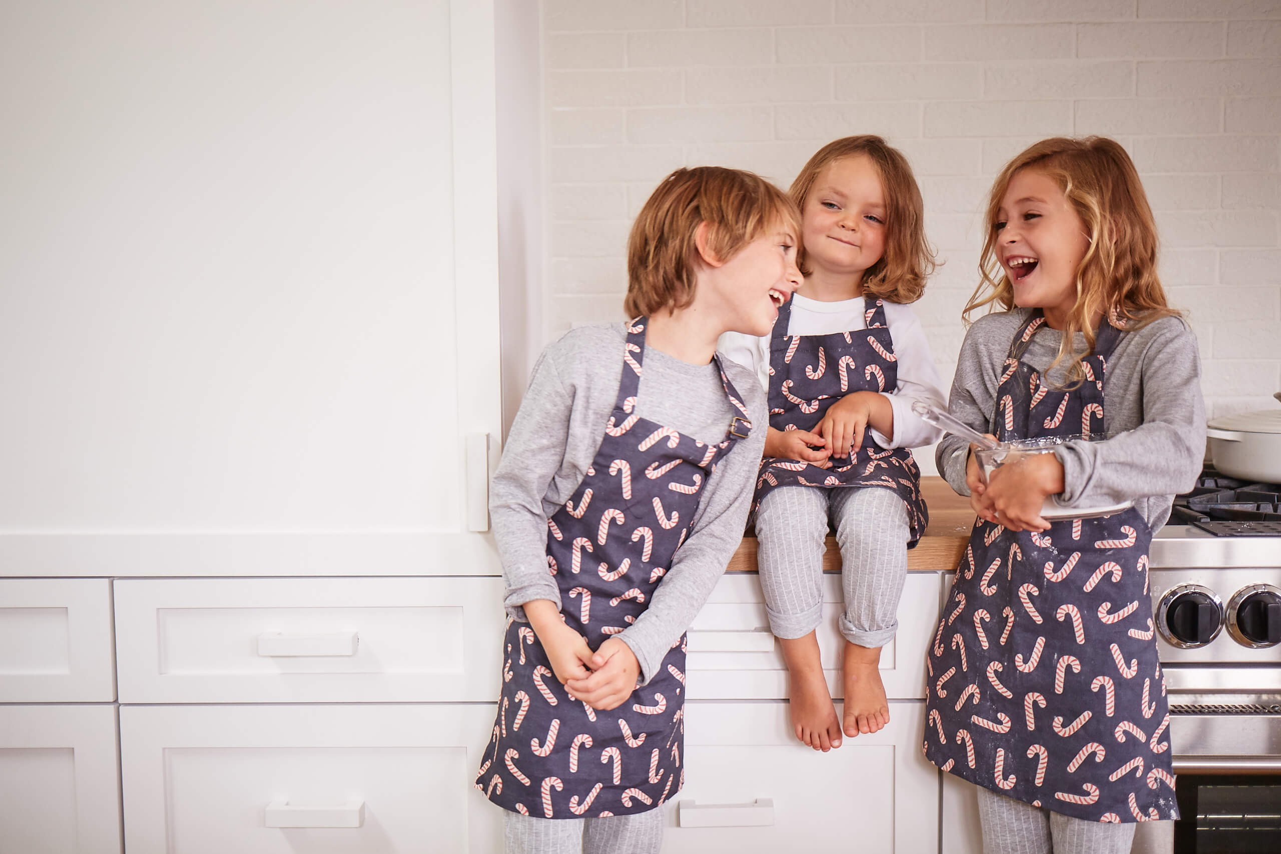 Kids laughing in aprons