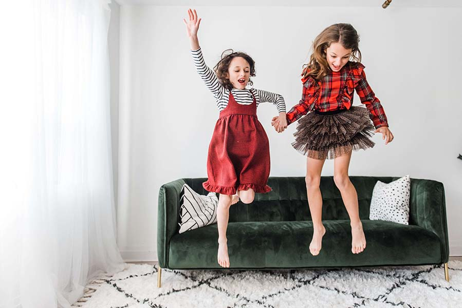 Kids jumping off couch