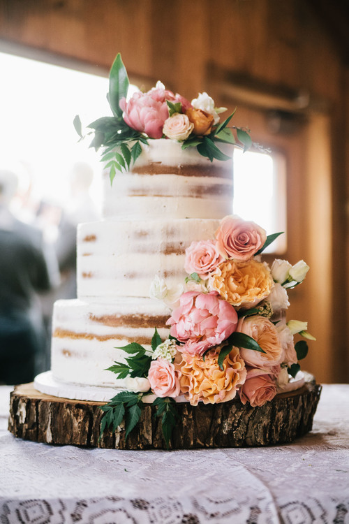 floral naked cake partially frosted
