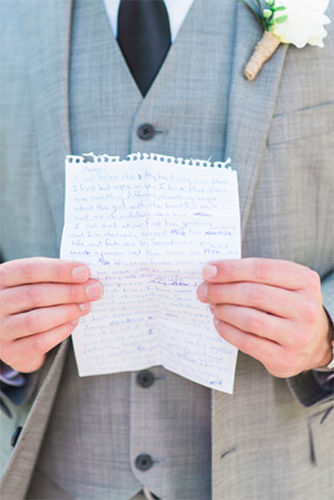 groom with handwritten wedding vows