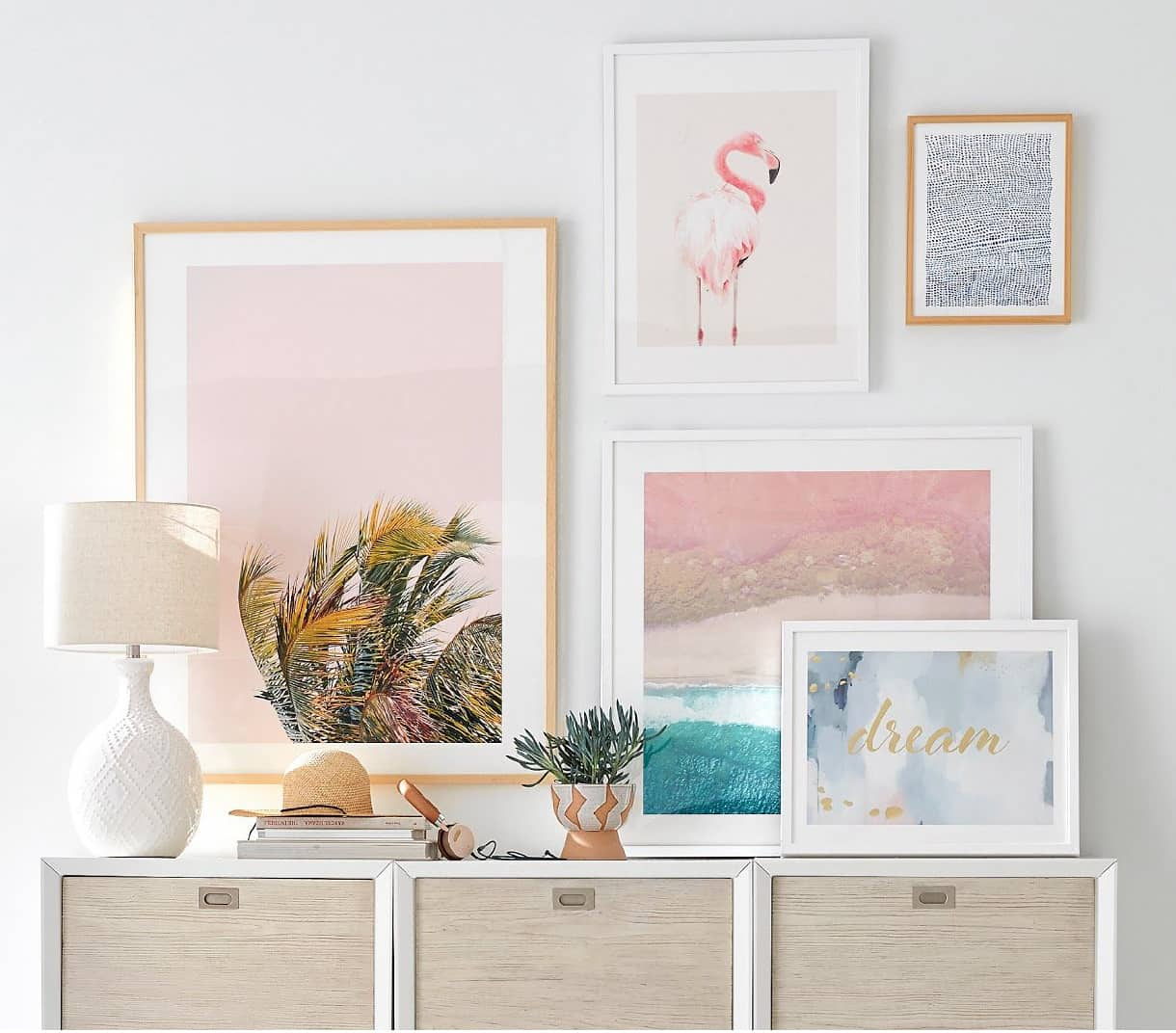 art prints resting on table and hanging on wall