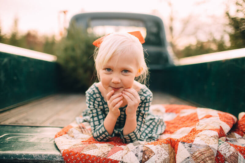 Daughter smiling in pickup truck