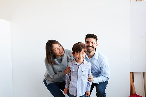Family smiling in matching color palette