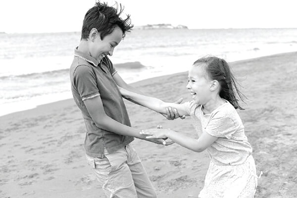 Kids laughing holding hands
