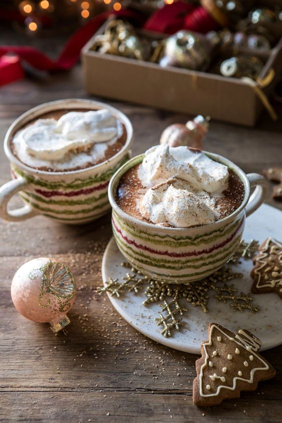 mugs of hot chocolate with whipped cream