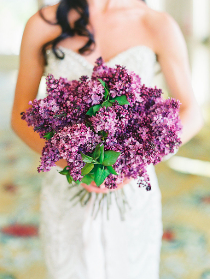 bride holding bouquet of lilacs