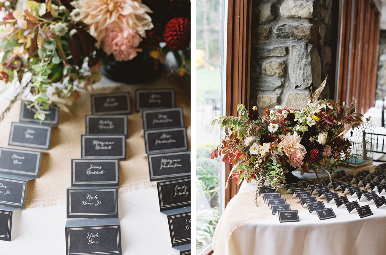 escort cards on table with flowers