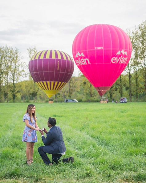 wedding proposal in front of hot air balloon