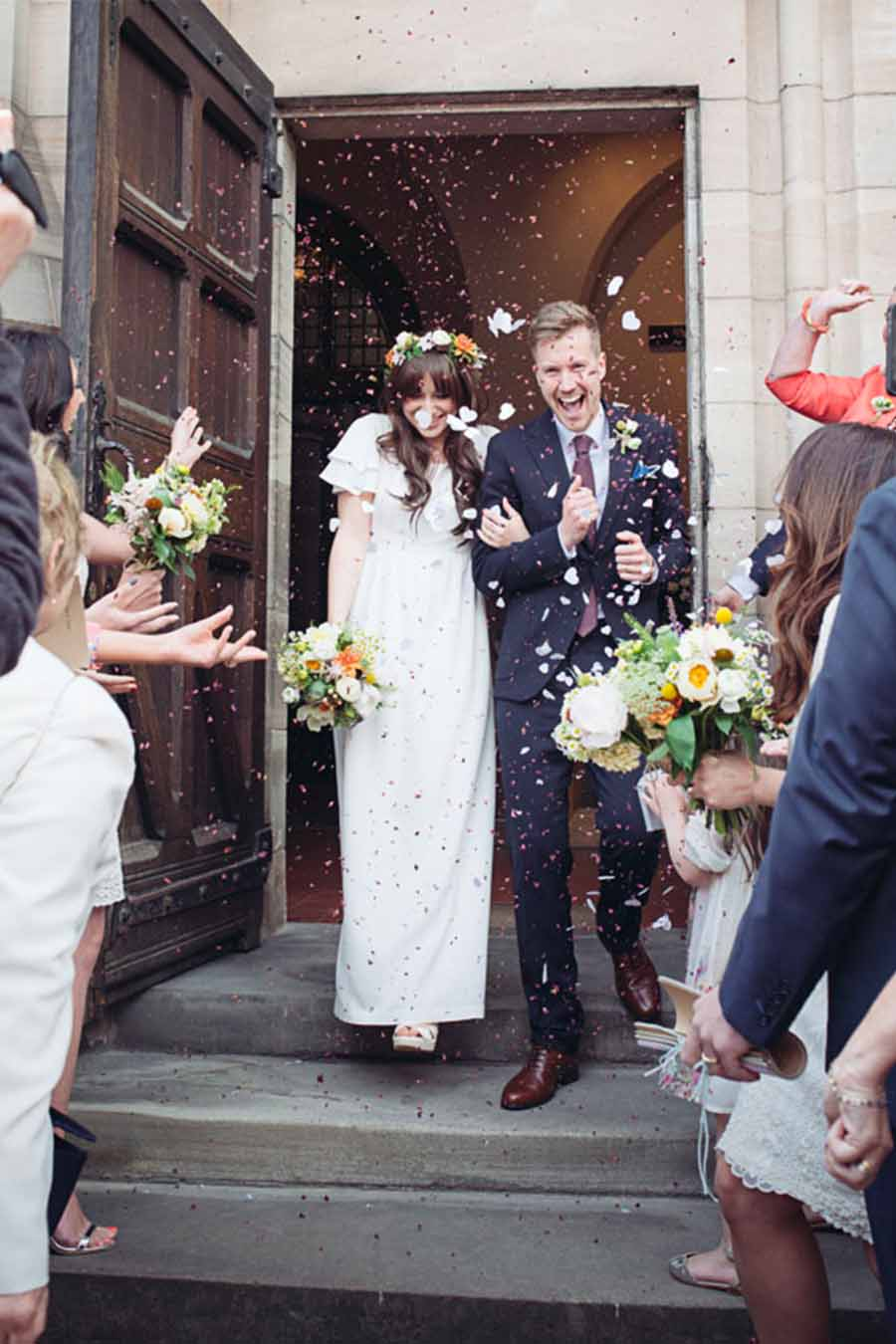 Bride and groom sprinkled with flowers