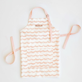 This is a pink apron by Rebecca Daublin called Sketchy Scallops in standard.