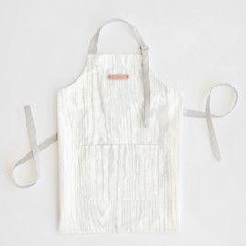 This is a white apron by Hooray Creative called Garden Lights in standard.