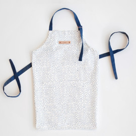 This is a blue apron by kelli hall called Speckled in standard.