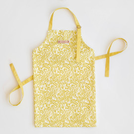 This is a yellow apron by Laura Hankins called Bold Botanical.