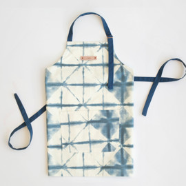 This is a blue apron by Flora Poste Studio called Hand-dyed Shibori Diamonds.