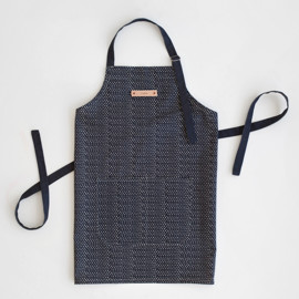 This is a blue apron by Tara Grangroth called Tiny Triangle.