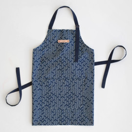 This is a blue apron by Lehan Veenker called Herringbone Incomplete in standard.