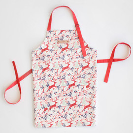 This is a colorful apron by Phrosne Ras called Jumping Reindeer.