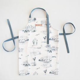This is a blue apron by Surface Love called Atlanta Modern Toile in standard.