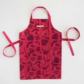 This is a red apron by Lehan Veenker called Soft Florals in standard.