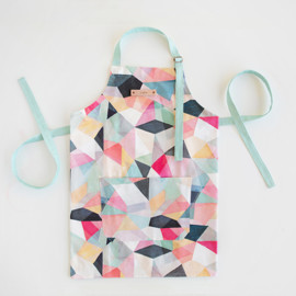 This is a colorful apron by Hooray Creative called Kaleidoscope No.1 in standard.